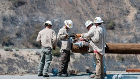 Southern California Edison crews and subcontractors replace fire damaged power and utility poles along Cajon Pass in San Bernardino County, Calif., Tuesday, Aug. 23, 2016. The state Department of Forestry and Fire Protection said the blaze in San Bernardino County mountain areas is 100 percent contained Tuesday. (James Quigg/The Daily Press via AP)