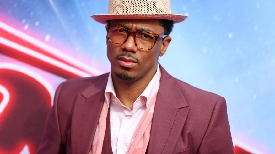 """FILE - In this March 3, 2016 file photo, Nick Cannon arrives at the """"America's Got Talent"""" Season 11 Red Carpet Kickoff at the Pasadena Civic Auditorium in Pasadena, Calif. Cannon, the host of """"America's Got Talent"""" and """"Wild 'n Out"""" has begun his freshman year at Howard University. Cannon posted photos on social media earlier this week of his first day on campus in Washington, D.C. Cannon was back on set of """"America's Got Talent"""" on Tuesday, Aug. 23, 2016. (Photo by Rich Fury/Invision/AP, File)"""