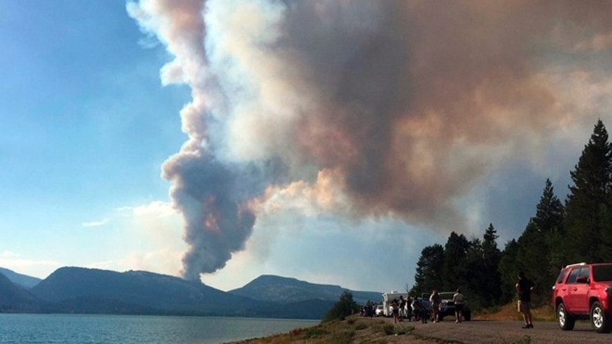 This Aug. 15, 2016, photo provided by Grand Teton National Park, shows smoke from the Berry Fire in Grand Teton National Park, Wyo.