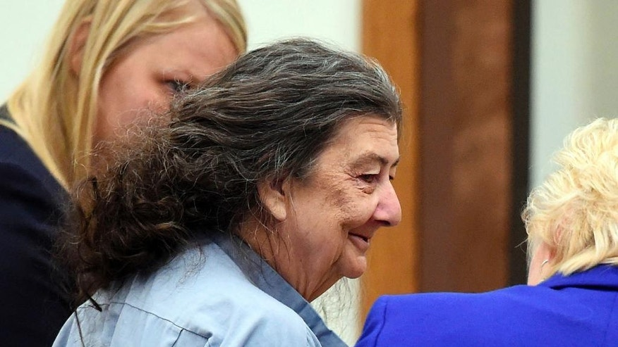 FILE - In this Sept. 8, 2014, file photo, Cathy Woods appears in Washoe District court in Reno, Nev. Woods, imprisoned for 35 years before being exonerated in a 1976 Reno murder case, is suing officials in Nevada and Louisiana on federal civil rights, malicious prosecution and conspiracy claims. (Andy Barron/The Reno Gazette-Journal via AP, File)
