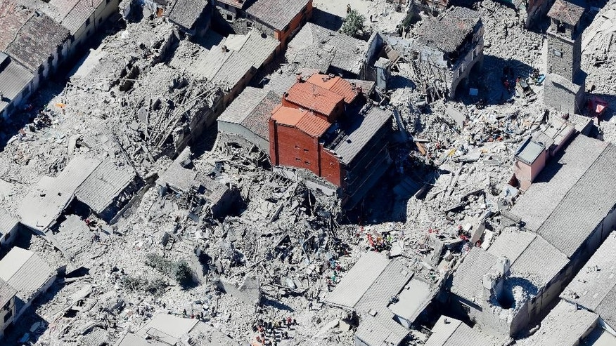This aerial photo shows the historical part of the town of Amatrice, central Italy, after an earthquake, Wednesday, Aug. 24, 2016. The magnitude 6 quake struck at 3:36 a.m. (0136 GMT) and was felt across a broad swath of central Italy, including Rome where residents of the capital felt a long swaying followed by aftershocks. (AP Photo/Gregorio Borgia)