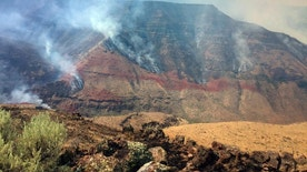 In this photo provided by inciweb.nwcg.gov, a wildfire smolders on the northwest side of Owyhee Canyon south of Vale, Ore., Wednesday, Aug. 24, 2016. The nearly 50-square-mile fire in eastern Oregon near the Idaho state line is now threatening Succor Creek State Park. (inciweb.nwcg.gov via AP)