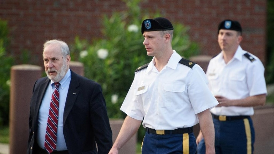Sgt. Bowe Bergdahl, center, arrives with his civilian attorney, Eugene Fidell, and military attorney, Lt. Col. Franklin Rosenblatt, for a hearing at the courtroom, Wednesday, Aug. 24, 2016, on Fort Bragg, N.C. Bergdahl, who disappeared in Afghanistan in 2009 and was held by the Taliban for five years, is charged with desertion and misbehavior before the enemy. (Andrew Craft/The Fayetteville Observer via AP)