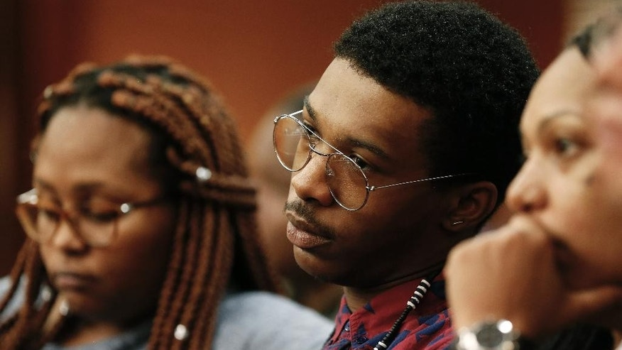 Marquez Tolbert watches during the trial for Martin Blackwell in Atlanta, Wednesday, Aug. 24, 2016. Blackwell is accused of pouring hot water on him and another man as they slept. (AP Photo/John Bazemore)