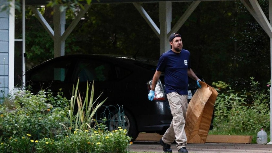 A Mississippi Bureau of Investigation agent takes a bag with evidence from the Durant, Miss., home of two slain Catholic nuns who worked as nurses at the Lexington Medical Clinic, to his vehicle, Thursday, Aug. 25, 2016. The clinic office manager and a Durant police officer discovered their bodies inside the house after both nuns did not report for work. (AP Photo/Rogelio V. Solis)