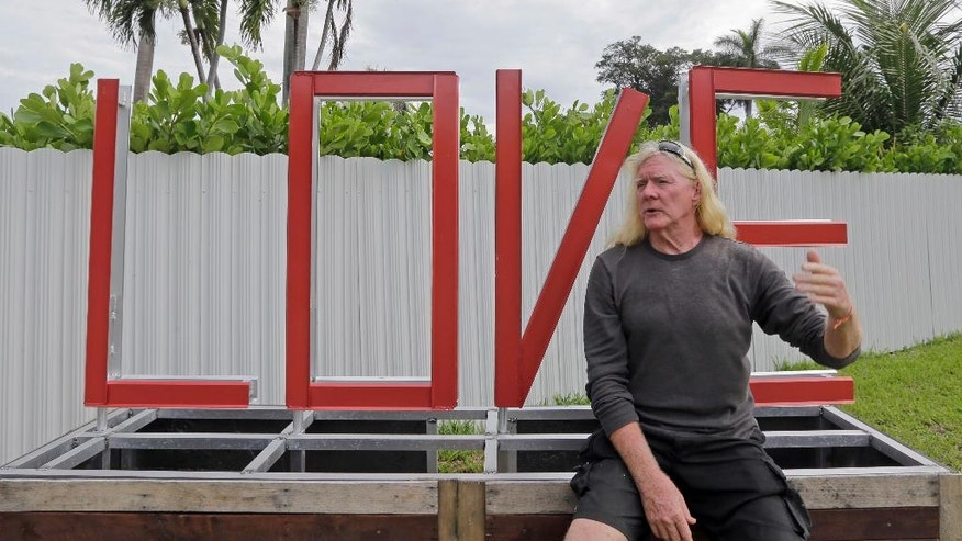 """In this photo taken, Aug., 11, 2016, Mickey Munday talks to a reporter in Love Park in North Miami, Fla. When he was one of Miami's notorious """"cocaine cowboys"""" in the 1980s, Mickey Munday made millions of dollars flying loads of drugs for Colombia's Medellin and Cali cartels. He knew infamous Medellin kingpin Pablo Escobar. He liked to fly his illicit cargo to out-of-the-way landing strips in the Everglades using high-tech gadgetry such as night-vision goggles. (AP Photo/Alan Diaz)"""