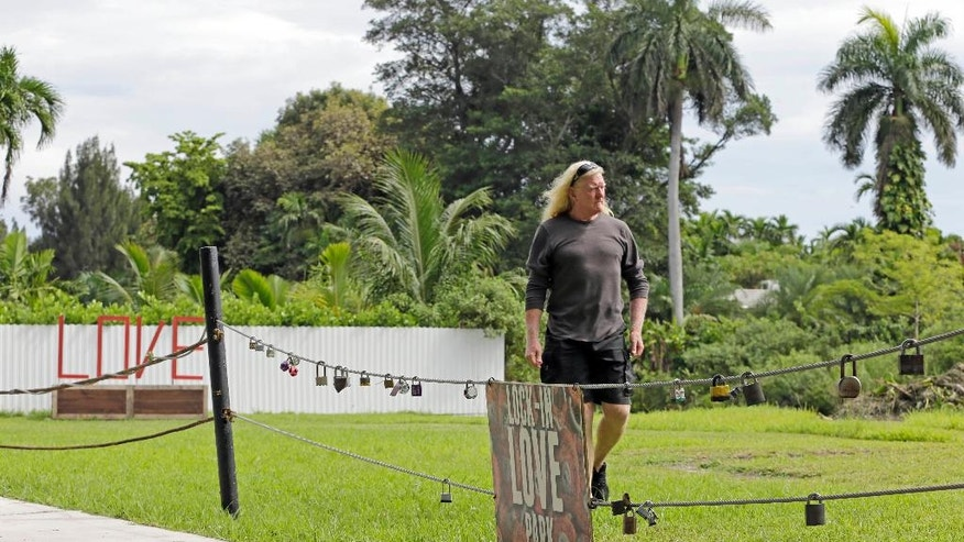 """In this photo taken, Aug., 11, 2016, Mickey Munday walks in Love Park in North Miami, Fla. When he was one of Miami's notorious """"cocaine cowboys"""" in the 1980s, Mickey Munday made millions of dollars flying loads of drugs for Colombia's Medellin and Cali cartels. He knew infamous Medellin kingpin Pablo Escobar. He liked to fly his illicit cargo to out-of-the-way landing strips in the Everglades using high-tech gadgetry such as night-vision goggles. (AP Photo/Alan Diaz)"""