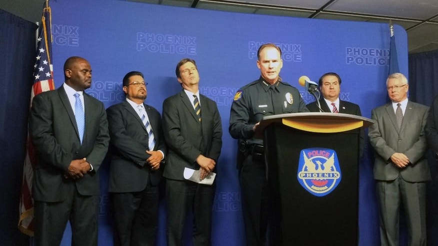 Phoenix Police Chief Joseph Yahner speaks at a news conference surrounded by officials in Phoenix on Thursday, Aug. 25, 2016. Phoenix police renewed pleas to the public Thursday for information that could help catch a serial killer who has been stalking predominantly Hispanic neighborhoods. (AP Photo/Terry Tang)