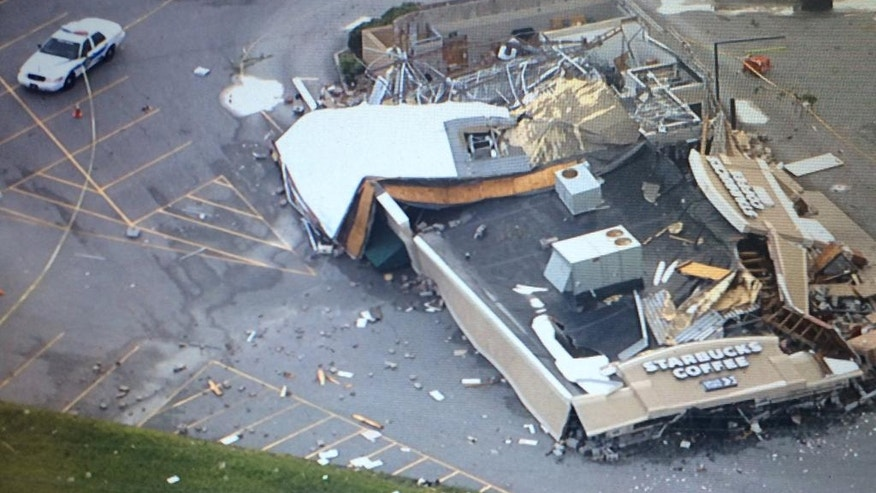 This image made from a video provided by WTHR 13 shows damage to a Starbucks after a tornado in Kokomo, Ind., Wednesday, Aug. 24, 2016. Multiple tornadoes touched down in central Indiana on Wednesday, tearing the roofs off apartment buildings, sending air conditioners falling onto parked cars and cutting power to thousands of people. (Nicole Misencik/WTHR 13 via AP)