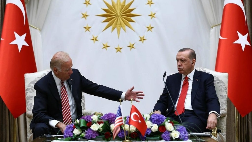 FILE - In this Aug. 24, 2016 file photo, Vice President Joe Biden meets with Turkish President Recep Tayyip Erdogan in Ankara, Turkey. Turkey says the U.S. is legally bound by a treaty to immediately hand over Fethullah Gulen, the U.S.-based Muslim cleric it accuses of plotting to overthrow Turkey's government. The U.S. government says it can't comply until Turkey can convince a judge its allegations against Gulen are legitimate.(Kayhan Ozer, Presidential Press Service Pool via AP, File)