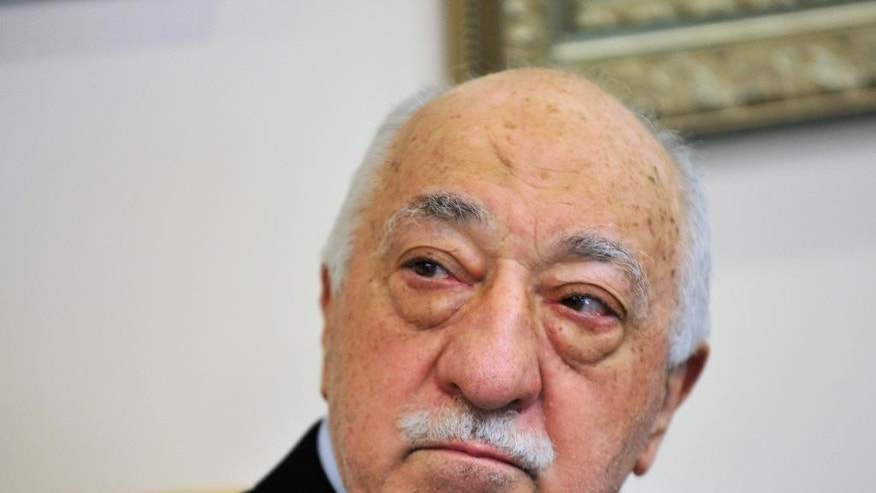 FILE - In this July, 2016 file photo, Islamic cleric Fethullah Gulen speaks to members of the media at his compound, in Saylorsburg, Pa. Turkey says the U.S. is legally bound by a treaty to immediately hand over Fethullah Gulen, the U.S.-based Muslim cleric it accuses of plotting to overthrow Turkey's government. The U.S. government says it can't comply until Turkey can convince a judge its allegations against Gulen are legitimate. (AP Photo/Chris Post, File)