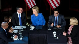 FILE - In this March 24, 2016 file photo, Democratic presidential candidate Hillary Clinton looks at Los Angeles Mayor Eric Garcetti, third from left, as she participates in a roundtable with Muslim community leaders at the University of Southern California in Los Angeles. Seated with Clinton from left are City of Los Angeles General Manager, Emergency Management Department James Featherstone, Senior Policy Analyst City of Los Angeles Human Relations Commission & Adjunct Assistant Professor (CSUDH) Joumana Silyan-Saba, Garcetti, President of the Muslim Public Affairs Council, Salam Al-Marayati, and Exucutieve Director of the Center for Religion and Civic Culture Brie Jeanette Loskota. (AP Photo/Carolyn Kaster, File)
