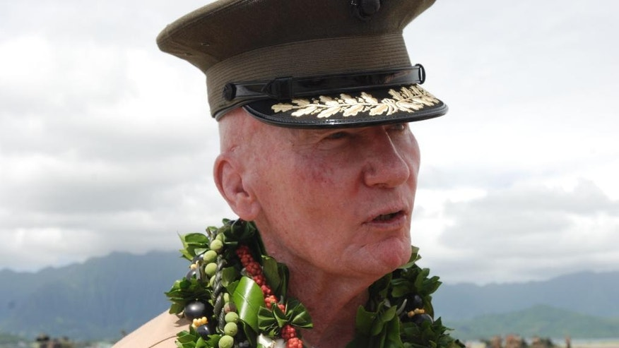 Lt. John Toolan speaks to reporters after a change of command ceremony in Kaneohe Bay, Hawaii on Friday, Aug. 26, 2016. The U.S. Marine Corps' new commander for the Pacific says he aims to carry on his predecessor's momentum on helping allies and partners develop their amphibious skills. (AP Photo/Audrey McAvoy)