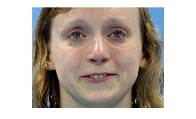 United States' Katie Ledecky cries, after winning gold, in the women's 800-meter freestyle medals ceremony during the swimming competitions at the 2016 Summer Olympics, Friday, Aug. 12, 2016, in Rio de Janeiro, Brazil. (AP Photo/Michael Sohn)