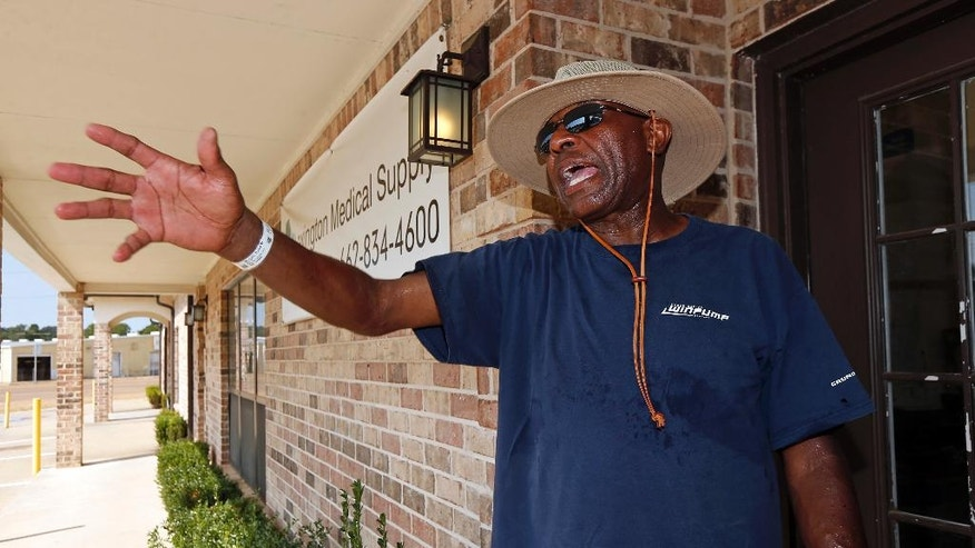 """""""Sister Paula was an angel,"""" says Joe Morgan Jr., of Lexington, Miss., Friday, Aug. 26, 2016, standing at a businesses adjacent to the Lexington Medical Clinic where he was a patient of Sister Paula Merrill, one of two nurse practitioners who were found slain Thursday in their Durant, Miss., home, a few miles away. Merrill and Sister Margaret Held, were known for their kindness and community involvement in the mostly rural Mississippi Delta towns.  (AP Photo/Rogelio V. Solis)"""