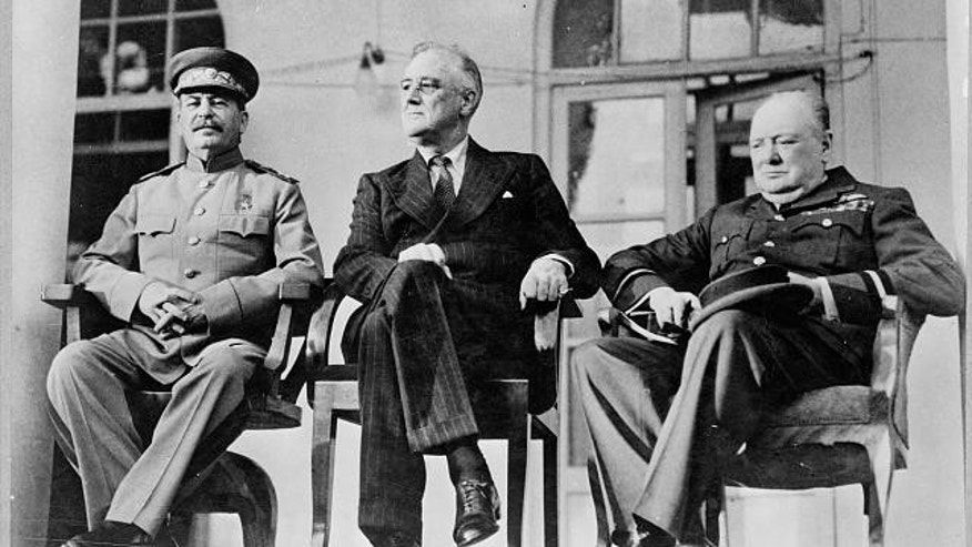 Joseph Stalin, Franklin D. Roosevelt and Winston Churchill sit on portico of Russian Embassy in Tehran, during conference in 1943. (Library of Congress)
