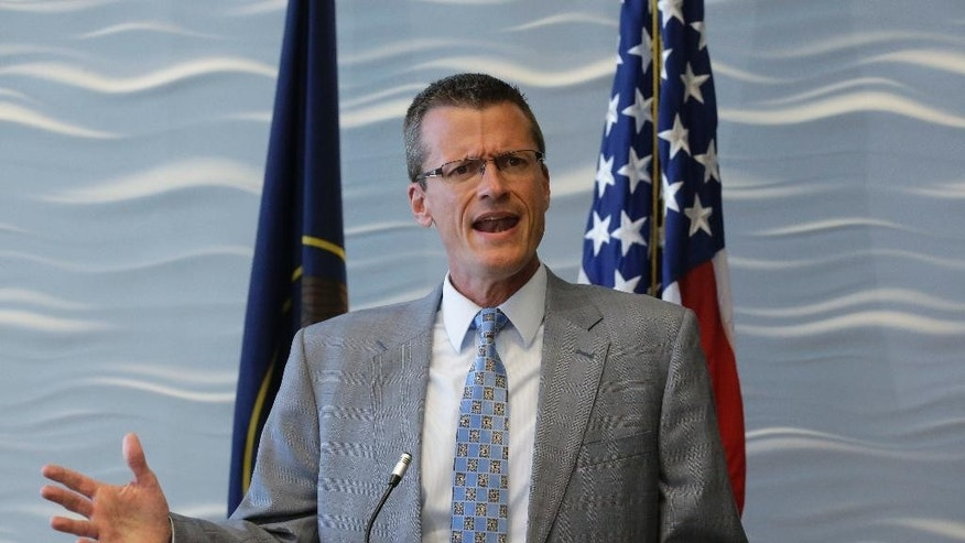 FBI special Agent in Charge Eric Barnhart speaks during a news conference Monday, Aug. 29,2016, in Salt Lake City. Federal authorities are offering a $50,000 reward for information leading to the arrest of fugitive polygamous sect leader Lyle Jeffs. Jeffs has been on the lam since June after slipping out of his GPS ankle monitor and escaping home confinement in Salt Lake City while awaiting trial on food stamp fraud charges. (AP Photo/Rick Bowmer)