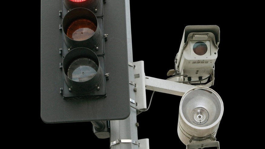 A red light camera setup is shown in Los Angeles