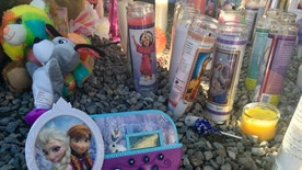 A memorial for a 10-year-old Albuquerque girl who police said was sexually assaulted, strangled then dismembered is shown at an Albuquerque apartment on Friday, Aug. 26, 2016 On the day a girl was going to celebrate her 10th birthday, she was found dead Wednesday in her family's apartment by Albuquerque police, her dismembered remains lying under a burning blanket. The girl's mother, 35-year-old Michelle Marten, her 31-year-old boyfriend, Fabian Gonzales, and his 31-year-old cousin, Jessica Kelley, are facing charges. (AP Photo/Russell Contreras)
