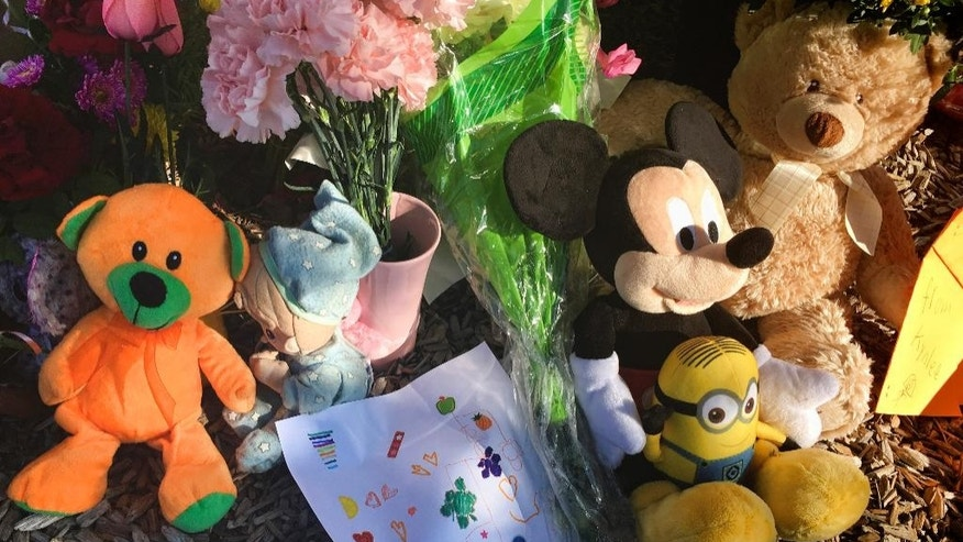 A memorial for a 10-year-old Albuquerque girl who police said was sexually assaulted, strangled then dismembered is shown at Petroglyph Elementary School, the girl Albuquerque school, on Friday, Aug. 26, 2016 On the day a girl was going to celebrate her 10th birthday, she was found dead Wednesday in her family's apartment by Albuquerque police, her dismembered remains lying under a burning blanket. The girl's mother, 35-year-old Michelle Marten, her 31-year-old boyfriend, Fabian Gonzales, and his 31-year-old cousin, Jessica Kelley, are facing charges. (AP Photo/Russell Contreras)