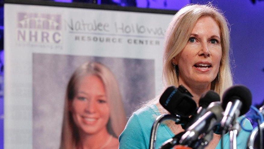 "FILE - In this June 8, 2010, file photo, Beth Holloway, mother of Natalee Holloway, speaks during the opening of the Natalee Holloway Resource Center (NHRC) at the National Museum of Crime & Punishment in Washington. Beth Holloway said on NBC's ""Today"" show Monday, August, 29, 2016, that justice hasn't been served in her daughter's death. (AP Photo/Pablo Martinez Monsivais, File)"