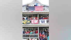 "In this April 30, 2016, photo, people stand on porches and balconies at a home on Mifflin Street during the annual block party in Madison, Wis. The Princeton Review's 2017 edition of the ""The Best 381 Colleges"" said Monday, Aug. 29, 2016, that the University of Wisconsin-Madison is the nation's top party school, followed by West Virginia and the University of Illinois. (Amber Arnold/Wisconsin State Journal via AP)"