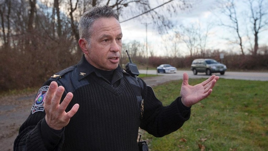 FILE – In this Dec. 18, 2015 file photo, the chief of police of the Newtown, Ohio, Police Department, Thomas Synan Jr., speaks to reporters at the scene of a traffic stop arrest in Newtown, Ohio. Synan Jr., who heads the Hamilton County Drug Coalition task force, said drug overdoses in the Cincinnati area dropped to 10 to 15 a day during the last weekend of August 2016, following a weeklong spike that exhausted emergency workers in the Cincinnati area and the neighboring states of Indiana, Kentucky and West Virginia. (AP Photo/John Minchillo, File)