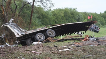 This Monday, Aug. 22, 2016, photo, provided by The Eagle Pass News Gram, shows what's left of a truck that exploded while carrying Takata inflators and a volatile chemical in the Texas border town of Quemado, killing a woman and injuring four others, according to The Eagle Pass News Gram. Takata Corp. said it sent people to the site and is helping authorities investigate the crash. (Ruben Carrillo Mazuka/The Eagle Pass News Gram via AP)