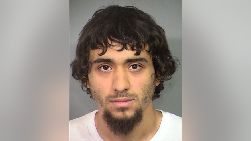 This undated booking photo provided by the Las Vegas Metropolitan Police Department shows Bryce Matthew Cuellar of Las Vegas. He is being held following his indictment on conspiracy and terrorism threat charges after police and prosecutors say he posed in battlefield gear with assault weapons and declared for an internet video audience that he intended to shoot Satanists and homosexuals. (Clark County Detention Center/Las Vegas Metropolitan Police Department via AP)