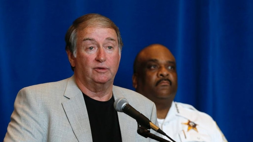 Retired Hammond, Ind., police detective Ronald Johnson, left, responds to a question as Chicago Police Superintendent Eddie Johnson listens during a news conference Wednesday, Aug. 31, 2016, in Chicago. Johnson, who was Hammond's chief investigator in the now unsolved murder of Alexandra Anaya, 11 years ago, joined Chicago authorities and the FBI in appealing for the public's help in solving Anaya's murder. (AP Photo/Charles Rex Arbogast)