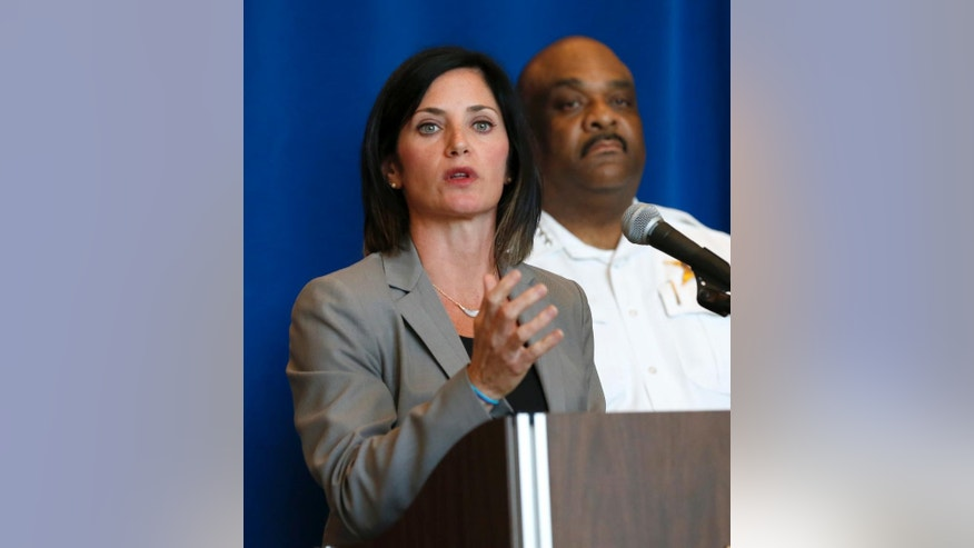 FBI Special Agent in Charge Courtney Corbett, left, responds to a question as Chicago Police Superintendent Eddie Johnson listens during a news conference Wednesday, Aug. 31, 2016, in Chicago. The FBI is appealing for the public's help in solving a more than a decade old killing of a 13-year-old Indiana girl, whose decapitated body was found by boaters in a river near Chicago. (AP Photo/Charles Rex Arbogast)