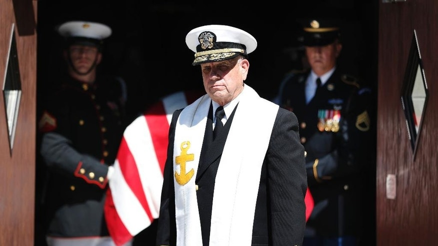 Retired Navy chaplain Rear Adm. Donald Muchow leads a procession of mourners after the funeral of former Army Gen. John Vessey, at Fort Snelling Chapel, Wednesday, Aug. 31, 2016 in St. Paul, Minn. Hundreds of mourners have gathered for a service honoring Vessey, a Minnesota native who became chairman of the Joint Chiefs of Staff under President Ronald Reagan. Vessey, who was 94 when he died Aug. 18., will be buried Thursday at the Minnesota Veterans Cemetery.  (Jerry Holt/Star Tribune via AP)