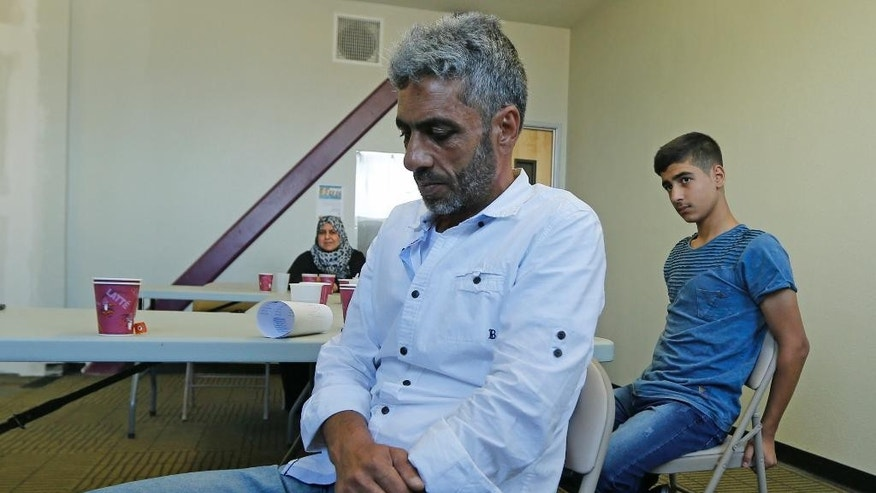 Nadim Fawzi Jouriyeh, a Syrian refugee who arrived in the United States with his wife and four children earlier this week, pauses to gather his emotions while talking about the years of waiting for the chance to come to the United States during an interview Wednesday, Aug. 31, 2016, in El Cajon, Calif. The family tells the AP they feel welcome in their new community of El Cajon, where many refugees are resettled where store signs are in Arabic and many speak their language.  (AP Photo/Lenny Ignelzi)