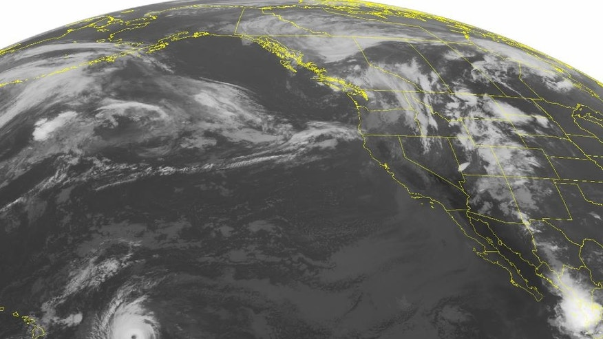 This NOAA satellite image taken Friday, September 02, 2016 at 01:00 AM EDT shows a clear eye associated with Hurricane Lester as it continues to move westward towards Hawaii. A band of showers has moved inland through the Pacific Northwest, making its way across Idaho and northern Nevada. Much of the rest of the Intermountain west remains unsettled, with scattered showers and embedded thunderstorms across the region and into eastern Montana as well. (NOAA/Weather Underground via AP)