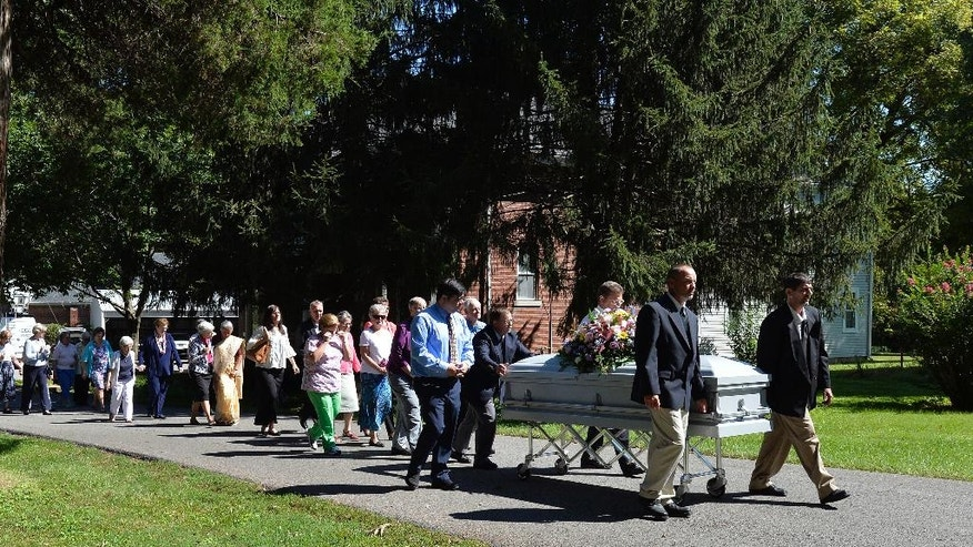 The casket containing the remains of Sister Paula Merrill leads the processional to her final resting place, following her funeral service, Friday, Sep. 2, 2016, in Bardstown, Ky. Sister Merrill, with the Sisters of Charity of Nazareth and another nun were found murdered in their home on Aug. 25 n Durant, Miss.  .(AP Photo/Timothy D. Easley)
