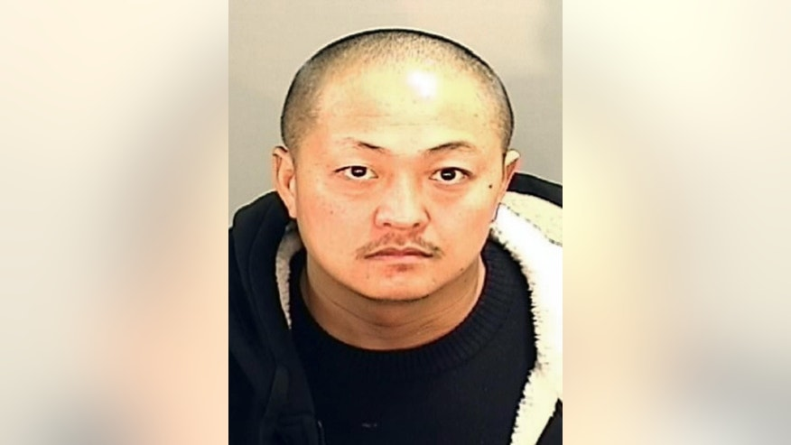 This undated photo provided by the Fresno County Sheriff's Office shows Thong Vang. Two unarmed officers were critically injured after being shot by a visitor in the lobby of a central California jail, authorities said Saturday. Authorities said officers from the secured areas inside the jail ran to the lobby, where a lieutenant fired shots at the gunman, identified as 37-year-old Vang, who was taken into custody. (Fresno County Sheriff's Office via AP)