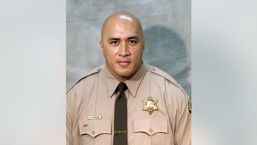 This undated photo provided by the Fresno County Sheriff's Office shows corrections officer Toamalama Scanlan. He was one of two unarmed officers critically injured after a man opened fire in the main lobby of the Fresno County Jail in downtown Fresno, Calif., Saturday, Sept. 3, 2016. Authorities said officers from the secured areas inside the jail ran to the lobby, where a lieutenant fired shots at the gunman, identified as 37-year-old Thong Vang, who was taken into custody. The injured officers were dragged out of the lobby and taken to the hospital to undergo surgery. (Fresno County Sheriff's Office via AP)