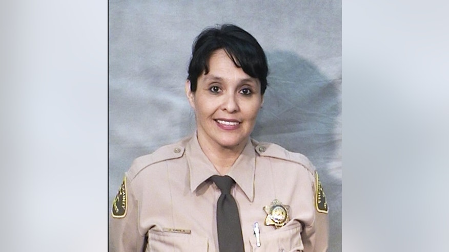 This undated photo provided by the Fresno County Sheriff's Office shows corrections officer Juanita Davila. She was one of two unarmed officers critically injured after a man opened fire in the main lobby of the Fresno County Jail in downtown Fresno, Calif., Saturday, Sept. 3, 2016. Authorities said officers from the secured areas inside the jail ran to the lobby, where a lieutenant fired shots at the gunman, identified as 37-year-old Thong Vang, who was taken into custody. The injured officers were dragged out of the lobby and taken to the hospital to undergo surgery. (Fresno County Sheriff's Office via AP)