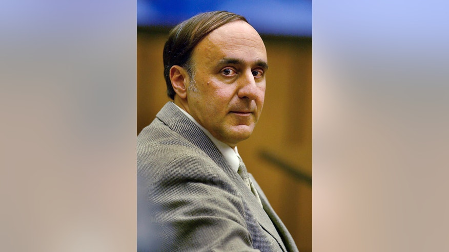 FILE - In this July 23, 2003 file photo, Steven Caruso sits in Middlesex Superior Court in Cambridge, Mass. Caruso, 48, is charged with murder in the January 2000 death of Sandra Berfield. Caruso is serving a life sentence for killing Sandra Berfield in 2000 with a pipe bomb in a package that exploded on her porch. The Massachusetts Supreme Judicial Court is scheduled to hear arguments in his appeal on Sept. 9, 2016. (George Martell/Boston Herald via AP, Pool)