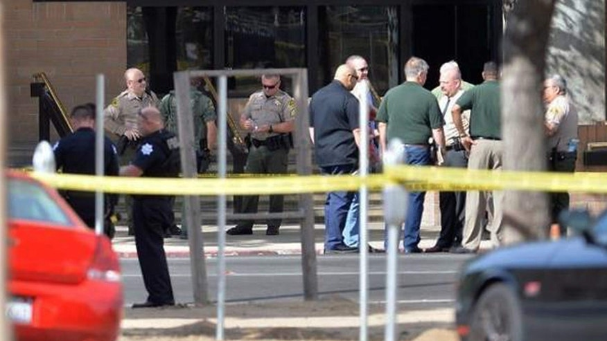 Sept. 3, 2016: Law enforcement officials and others are seen outside the lobby of the Fresno County Jail after reports of an active shooter in the main lobby of the jail in downtown Fresno, Calif.