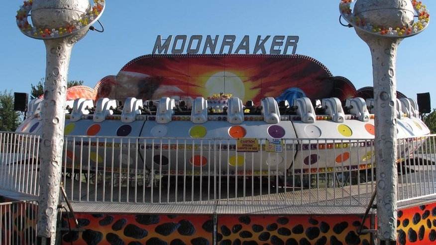 The Moonraker ride sits idle after several riders were taken to hospitals after it shut down at the Delta Fair in Memphis, Tenn., on Saturday, Sept. 3, 2016. Matt Snyder, the fair's safety director, said the ride's computer detected a problem and immediately began a safety shutdown, but as it began to descend, the operator panicked and pressed a manual override button that released the safety restraints before it settled into its cradle. (AP Photo/Adrian Sainz)