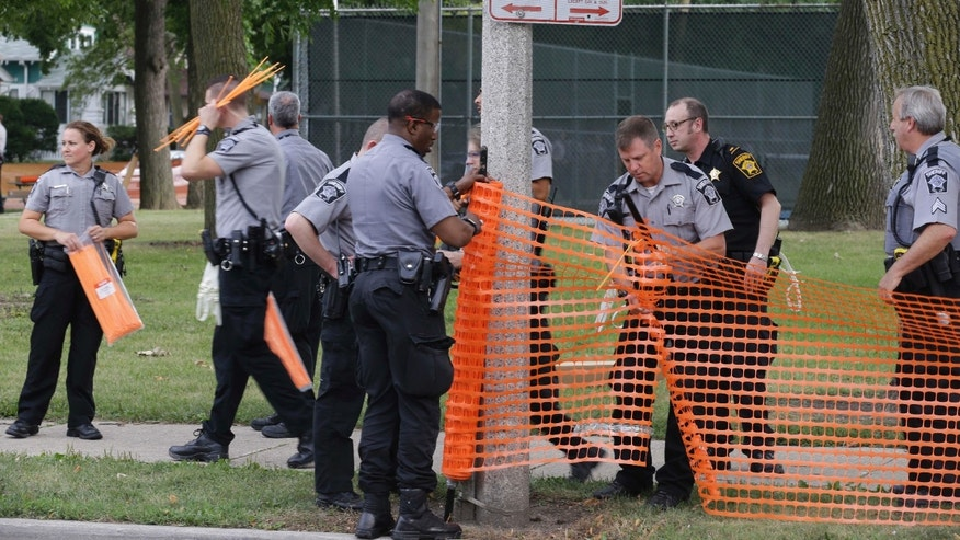 Aug. 15, 2016: Police prepare to close a park in Milwaukee.