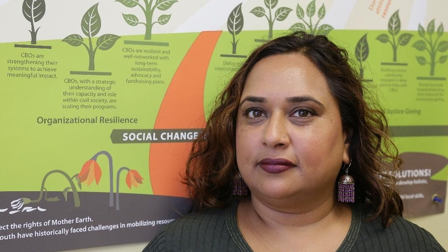 In this photo taken Friday, Sept. 2, 2016, Rajasvini Bhansali, executive director of the International Development Exchange, also known as IDEX, poses at her office in San Francisco. Black Lives Matter has quietly established a legal partnership with the California charity in a sign of the movement's growth and expanding ambition. The nonprofit charity also known as IDEX has been acting since November as a mostly unseen financial arm of Black Lives Matter, which two years ago grew out of street protests and a hashtag. (AP Photo/Eric Risberg)