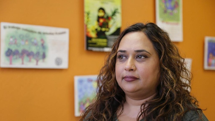 In this photo taken Friday, Sept. 2, 2016, Rajasvini Bhansali, executive director of the International Development Exchange, also known as IDEX, poses at her office in San Francisco. Black Lives Matter has quietly established a legal partnership with the California charity in a sign of the movement's growth and expanding ambition. The Associated Press has learned that IDEX is managing the group's financial affairs, allowing Black Lives Matter to focus on its mission, including building local chapters and experimenting with its organizational structure. (AP Photo/Eric Risberg)