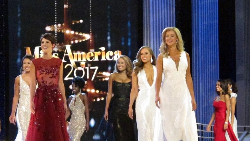 Contestants in the evening gown portion of the Miss America pageant compete on the first night of preliminary competition in Atlantic City, Tuesday, Sept. 6, 2016. Tuesday night is the first of three nights of preliminary competition lasting through Thursday. The 2017 Miss America will be crowned during Sunday night's nationally televised finale on ABC. (AP Photo/Wayne Parry)