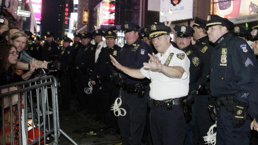 FILE - In this Saturday, Oct. 15, 2011 file photo, New York Police Department chief Joseph Esposito addresses the Occupy Wall Street protesters as they arrive for a rally at Times Square in New York. He remembers the support police enjoyed in the wake of the Sept. 11, 2001 attacks, and how much the tone had changed by the time of the Occupy protests in 2011, when police arrested hundreds of demonstrators, many of whom said cops unjustly rounded and roughed them up. (AP Photo/David Karp)