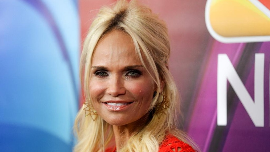 """FILE - In a Tuesday, Aug. 2, 2016 file photo, Kristin Chenoweth, a cast member in the television special """"Hairspray Live!,"""" arrives at the NBCUniversal Television Critics Association summer press tour, in Beverly Hills, Calif. """"Glee"""" and """"Wicked"""" star Kristin Chenoweth will star in """"My Love Letter to Broadway"""" from Nov. 2-13, 2016, at the Lunt-Fontanne Theatre. (Photo by Rich Fury/Invision/AP, File)"""