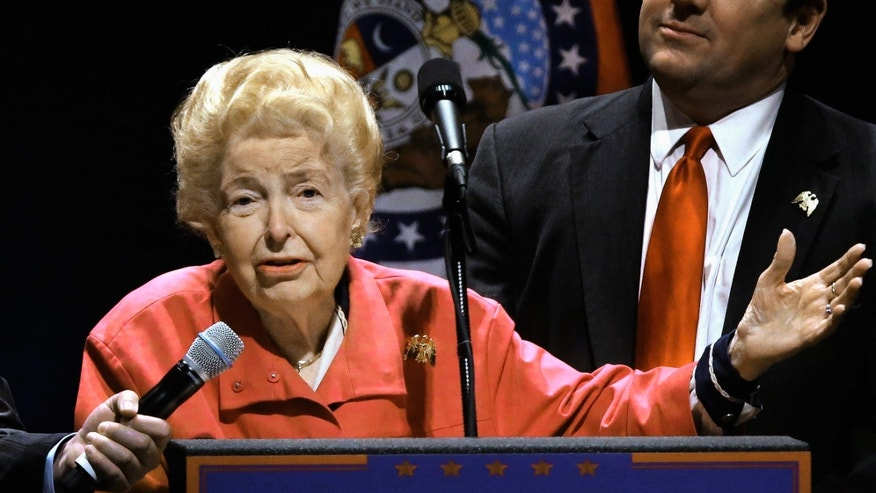 FILE -- March 11, 2016: Longtime conservative activist Phyllis Schlafly endorses Republican presidential candidate Donald Trump before Trump begins speaking at a campaign rally in St. Louis.