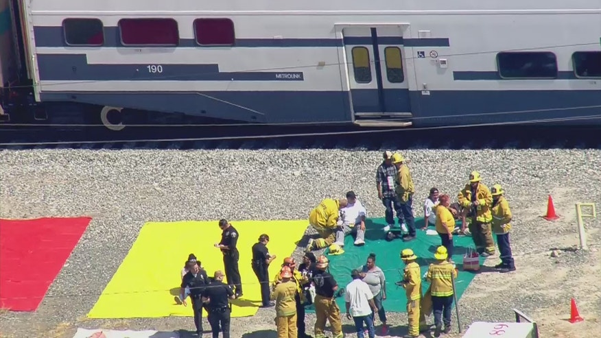 Sept. 6, 2016: Injured passengers are treated by paramedics after a Metrolink commuter train collided with a box truck outside Los Angeles