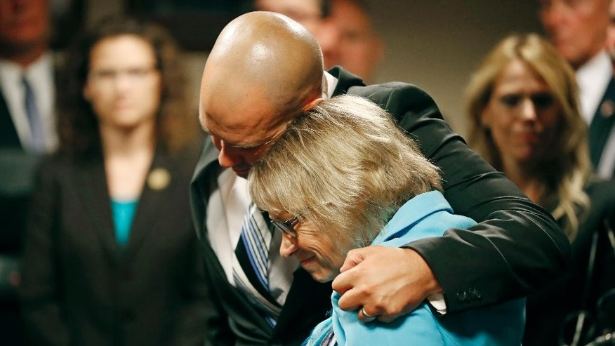 "Patty Wetterling is consoled by son Trevor during a news conference after a hear for Danny Heinrich, Tuesday, Sept. 6, 2016 in Minneapolis. Heinrich confessed Tuesday to abducting and killing 11-year-old Jacob Wetterling nearly 27 years ago, recounting a crime that long haunted the state with details that included Jacob asking right after he was taken: ""What did I do wrong?"" (Jerry Holt/Star Tribune via AP)"